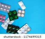 different pills on blue... | Shutterstock . vector #1174699315