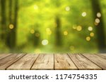 wooden table with blurred... | Shutterstock . vector #1174754335