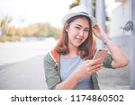 asia woman using with smart... | Shutterstock . vector #1174860502