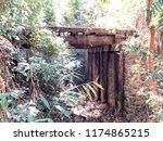 abandoned timber bridge river... | Shutterstock . vector #1174865215