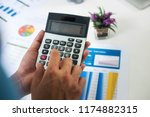 asian businessman or accountant ... | Shutterstock . vector #1174882315