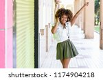 young attractive black woman in ... | Shutterstock . vector #1174904218
