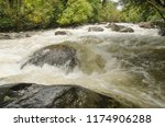 strong tides with stones in the ... | Shutterstock . vector #1174906288