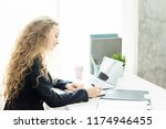 business woman working at... | Shutterstock . vector #1174946455
