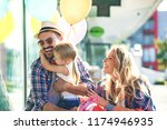 happy family walking along the... | Shutterstock . vector #1174946935