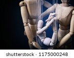 close up mannequin parents hold ... | Shutterstock . vector #1175000248