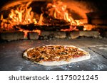 pizza preparations in a self... | Shutterstock . vector #1175021245