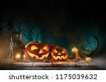 halloween pumpkins on wooden... | Shutterstock . vector #1175039632