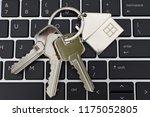 three metal keys with keychain... | Shutterstock . vector #1175052805