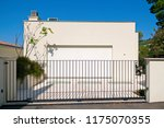 metal gates. new luxury family... | Shutterstock . vector #1175070355