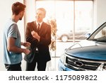 the man and the dealer talk... | Shutterstock . vector #1175089822