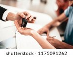 showroom dealer the gives car... | Shutterstock . vector #1175091262