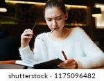 focused young girl freelancer... | Shutterstock . vector #1175096482