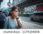 woman feel sick on hong kong... | Shutterstock . vector #1175104858