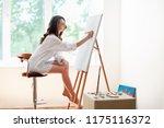pretty female artist painting... | Shutterstock . vector #1175116372