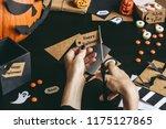 halloween preparation. hands... | Shutterstock . vector #1175127865