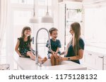 mother with her children... | Shutterstock . vector #1175128132
