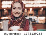 a charming muslim girl with a... | Shutterstock . vector #1175139265