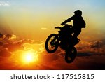 silhouette of a motorcyclist on ... | Shutterstock . vector #117515815