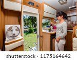 woman cooking in camper ... | Shutterstock . vector #1175164642