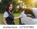 young woman holding smart key... | Shutterstock . vector #1175197882