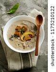 mushroom soup with champignons | Shutterstock . vector #1175210122