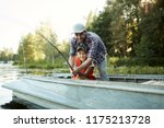 happy father and son holding... | Shutterstock . vector #1175213728