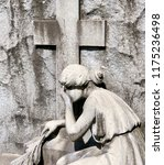 girl weeping graveside with...   Shutterstock . vector #1175236498