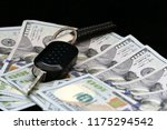 car's ignition and 100 dollars | Shutterstock . vector #1175294542