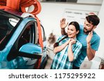 a guy shows a new car to... | Shutterstock . vector #1175295922