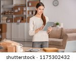young woman with tablet...   Shutterstock . vector #1175302432