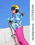 Girl with ski on the snow - stock photo