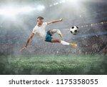 soccer player on a football... | Shutterstock . vector #1175358055