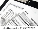 1040  433 tax forms and pen.... | Shutterstock . vector #1175370202