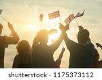waving uk flags. british people ... | Shutterstock . vector #1175373112