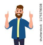 young man pointing up fingers... | Shutterstock .eps vector #1175378038