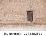 old wooden door on a brick wall. | Shutterstock . vector #1175382532