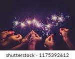 beautiful sparklers in people... | Shutterstock . vector #1175392612