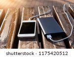 bank of power and phone on the... | Shutterstock . vector #1175420512