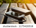 bank of power and phone on the... | Shutterstock . vector #1175420518