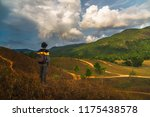 man traveler stand alone on top ... | Shutterstock . vector #1175438578