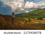 man traveler stand alone on top ... | Shutterstock . vector #1175438578