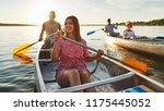 smiling young woman paddling a... | Shutterstock . vector #1175445052