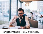 concentrated hipster guy in... | Shutterstock . vector #1175484382