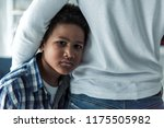 sad afro american boy in casual ... | Shutterstock . vector #1175505982