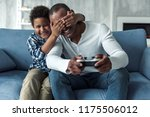 happy afro american father and... | Shutterstock . vector #1175506012