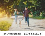 dog with owners spend a day at... | Shutterstock . vector #1175551675