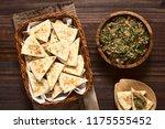 homemade sesame pita chips with ... | Shutterstock . vector #1175555452