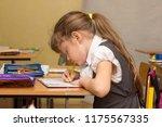a schoolgirl in a lesson... | Shutterstock . vector #1175567335