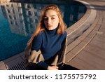luxurious confident girl blonde ... | Shutterstock . vector #1175575792
